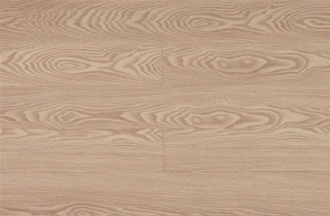 多层实木地板,其生产工艺是将木材切成单板